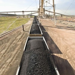 Coal is loaded onto rail cars leaving a coal mine in the Powder River Basin in Wyoming.