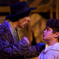 "Cast members Zachary Spreng (right), who plays Oliver Twist, and Dominick Varney, who plays Fagin, run through a scene during rehearsal of ""Oliver!"" on Saturday at the Bangor Opera House in Bangor. The show runs from Dec. 1 through Dec. 24."