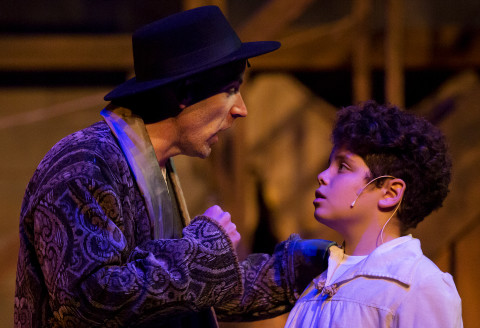 Cast members Zachary Spreng (right), who plays Oliver Twist, and Dominick Varney, who plays Fagin, run through a scene during rehearsal of &quotOliver!&quot on Saturday at the Bangor Opera House in Bangor. The show runs from Dec. 1 through Dec. 24.