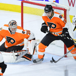 Boston Bruins left wing Brad Marchand (right) scores a goal against Philadelphia Flyers defenseman Michael Del Zotto (15) and goalie Steve Mason (35) during the third period at Wells Fargo Center in Philadelphia Tuesday night. The Flyers defeated the Bruins, 3-2 in a shootout.