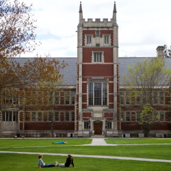 Students sit on the quad in front of Hubbard Hall at Bowdoin College in Brunswick.
