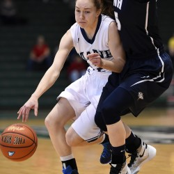 Sigi Koizar of the University of Maine tries to maneuver around New Hampshire's Elizabeth Belanger the America East quarterfinal at Vestal, New York in March. The Black Bears won 58-47 behind 23 points from Koizar.