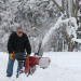 Chip Wilde of Houlton clears snow from his driveway Wednesday morning after nearly a foot of snow fell in the Shiretown. Another storm was expected to hit the area Wednesday night into Thursday.