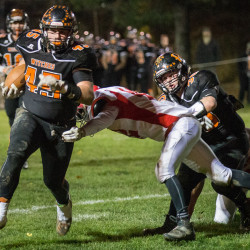Brewer High School's Trey Wood (left) escapes a tackle by Jason Barnes (center) with help from teammate Zac Duncan during their Class B high school football semifinal playoff game on Doyle Field on Nov. 4.