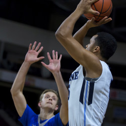 University of Maine's Danny Evans (right) tries for two past Central Connecticut State University's Tidell Pierre during their basketball game at the Cross Insurance Center in Bangor Wednesday.