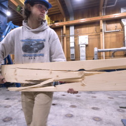 Rylan Norris removes a broken 2-by-6 board while testing Norway spruce lumber at the University of Maine Advanced Structures and Composites Center in Orono in this December 2015 file photo.