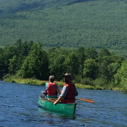 U.S. Secretary of the Interior Sally Jewell (left) and Lucas St. Clair of Elliotsville Plantation Inc. paddle on the East Branch of the Penobscot River in the new Katahdin Woods and Waters National Monument on Saturday, Aug. 27, 2016.