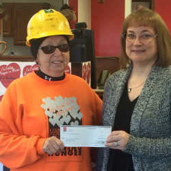 Brenda Davis (left) receives a donation from Maine Savings' Karla Kelley on behalf of the credit union at its Corinth branch, November 18.