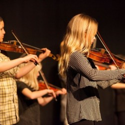 Eastport Strings 'regulars' Antonio Vizcarrondo (left) and Lulu Calame are pictured during the spring intensive.