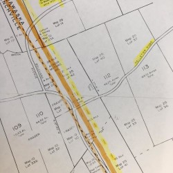 A boundary map depicts the various iterations of the Town Line between Madawaska and Frenchville along the Pelletier Avenue road.