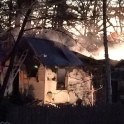 One woman has died after fire swept through her home in Windham on Friday morning.