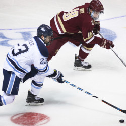 University of Maine's Sam Becker (left) fights for the puck with Boston College's Colin White at the Cross Insurance Arena in Portland, Nov. 4, 2016.