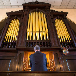 "St. John Catholic Church music director Kevin Birch plays the ""new"" pipe organ at Hammond Street Congregational Church on Monday, now fully operational after a yearlong installation process. The organ was salvaged from a church in Boston and had not been played for 60 years. Sunday the church is hosting the first recital with the organ at full capabilities."