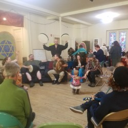 Merlin Littlefield, Michael Kelly and Alana Cassanelli lead a drum circle during Eastern Maine Pagan Pride Day on Saturday at the Unitarian Universalist Church in Bangor.