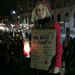 Meg Lemay stands on Monument Square during a Gathering of Unity Vigil on Wednesday night.