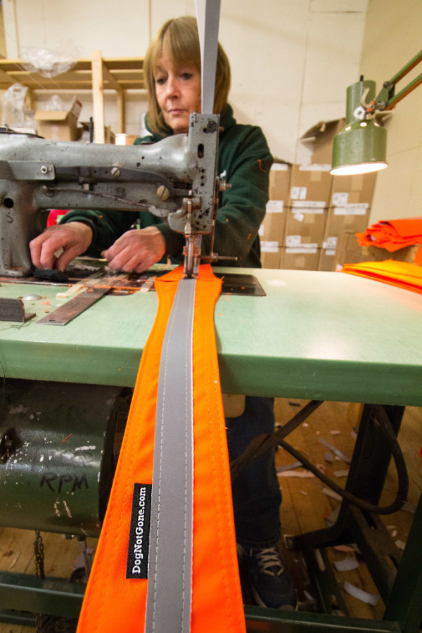 Sherry Jewell of Smithfield sews reflective material on the neck piece of a Dog Not Gone dog vest on Nov. 1, at Maine Stitching Specialties in Skowhegan, where she has worked since 1981. Since Dog Not Gone was established in 2005, Qurion has been making products for the company.
