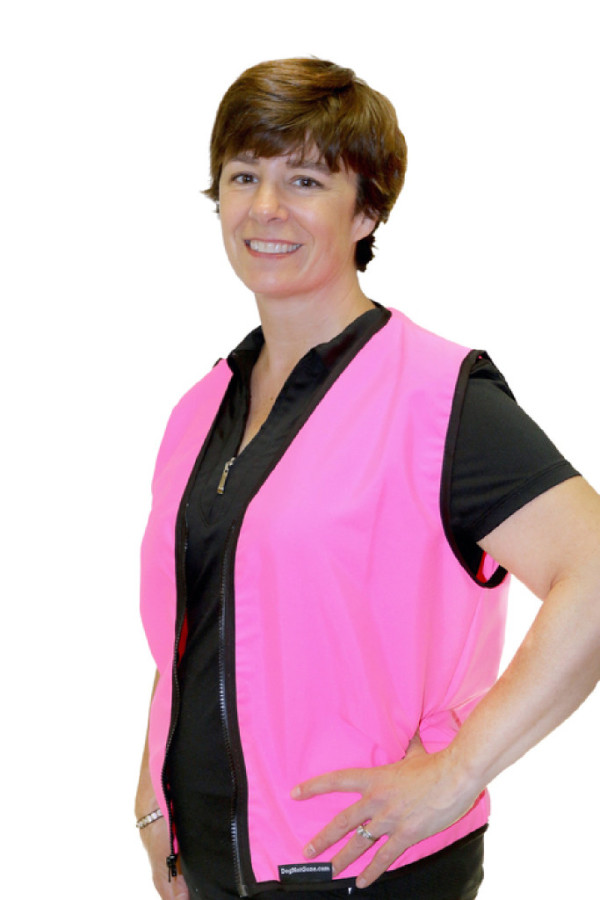 Julie Swain, co-owner and founder of Dog Not Gone, models the neon pink Dog Not Gone tick- and mosquito-repelling vest, launched by the company in January 2016. The vest is made of No Fly Zone, a fabric treated with permethrin and patented by Burlington Labs.