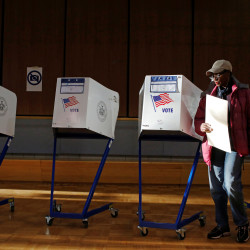 A woman exits the voting booth after filling out her ballot for the U.S presidential election at the James Weldon Johnson Community Center in the East Harlem neighborhood of Manhattan, New York City, Nov. 8, 2016.