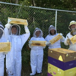 Hampden Academy beekeepers show off some of this year's honey crop.