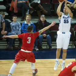 University of Maine's Garet Beal (right) shoots for three past Stony Brook University's Kameron Mitchell during their basketball game at the Cross Insurance Center in Bangor in this January 2015 file photo.
