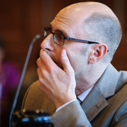 Gregory Nisbet listens to a statement from Lisa Leconte-Mazziotti, mother of Nicole Finlay, who died in a fire in a building owned by Nisbet in 2014, on Thursday in court in Portland. Nisbet was later sentenced to serve 90 days in county jail and pay a fine of $1,000.