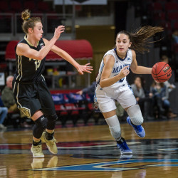 University of Maine's Blanca Millan (right) looks to move past Purdue's Bridget Perry during their basketball game on Nov. 11 at the Cross Insurance Center in Bangor.