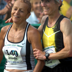 Race founder Joan Benoit Samuelson (right) finishes alongside fellow former Boston Marathon winner Jacqueline Gareau of Montreal in the 10th annual Beach To Beacon 10K in Cape Elizabeth in this August 2007 file photo.