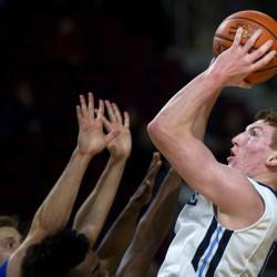 University of Maine's Andrew Fleming (right) tries for two past Central Connecticut State University during their basketball game at the Cross Insurance Center in Bangor Wednesday.