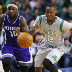 Sacramento Kings guard Ty Lawson (left) and Boston Celtics guard Terry Rozier eye a loose ball during the second half of the Boston Celtics' 97-92 win over the Sacramento Kings at TD Garden in Boston on Friday night.