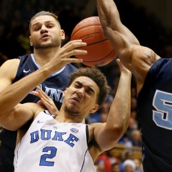 Duke's Chase Jeter (2) pulls in a rebound between the University of Maine's Marko Pirovic and Vincent Eze (right ) in the second half Saturday's game at Cameron Indoor Stadium in Durham, North Carolina.