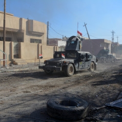 Military vehicles of Iraqi security forces are seen during a battle with Islamic State militants in Mosul, Dec. 4, 2016.