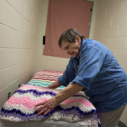 Norma, 77 years old, makes her bed in what used to be a closet at the Maine Correctional Center where photographer Jessica Earnshaw spent several days shadowing Maine's oldest female inmate as part of the Aging in Prison photo documentary project.