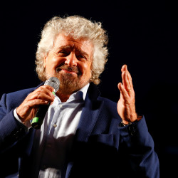 Beppe Grillo, the founder of the anti-establishment 5-Star Movement, talks during a march in support of the 'No' vote in the upcoming constitutional reform referendum in Rome, Italy November 26, 2016.