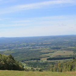 Looking west from the summit of Big Rock Mountain, towards the town of Mars Hill and central Aroostook County's unorganized territories. To the southwest, on left, are the highlands around Number Nine Mountain, the proposed site of a 119-turbine wind farm.