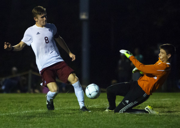 Brewer's Drew Baker (right) stops a shot from Bangor's Carson Atherley during their soccer game on Sept. 7 in Bangor.