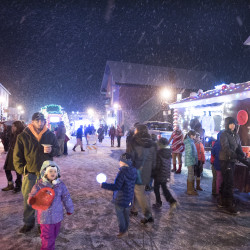 People walk around to check the stationary floats during the Light Up The Night event in Orono on Monday.
