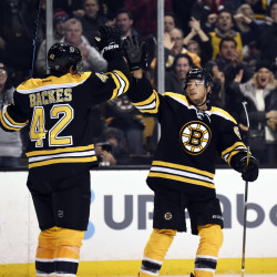 Boston Bruins right wing David Backes (left) high fives center Ryan Spooner after scoring a goal during the third period against the Florida Panthers at TD Garden in Boston on Monday night.