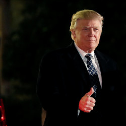 U.S. President-elect Donald Trump gives a thumbs up to the media as he arrives at a costume party at the home of hedge fund billionaire and campaign donor Robert Mercer in Head of the Harbor, New York, U.S., December 3, 2016.