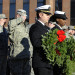 Lt. Cmdr. Matt Billings (left) and petty officer Vekisha McCall of the Navy Operational Support Center in Bangor prepare to release two wreaths into the Kenduskeag Stream during the Pearl Harbor Remembrance Day ceremony on Dec. 7, 2015, in Bangor. The ceremony was held on the Willard Carleton Orr Bridge, a pedestrian bridge named in honor of Orr, a Bangor resident who died at Pearl Harbor.