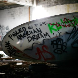 A boat filled with graffiti is seen inside the abandoned and decaying manufacturing plant of Packard Motor Car in Detroit, Michigan, April 2, 2011.