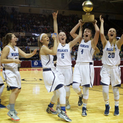 York High School players celebrate their win in the girls Class A basketball championship game in Portland in this February 2016 file photo. Emma Thomson, a former York player, has been a shooting star for Fitchburg State University.