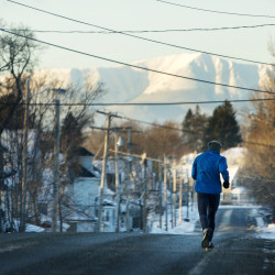Ben Barr, who will be among about 950 participants in the Millinocket Marathon & Half on Saturday, goes on a 5-mile training run Tuesday in Millinocket. Instead of paying an entry fee, runners are encouraged to spend at area shops, restaurants and hotels.