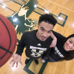 Darla Morales (right), 21, and her boyfriend, Alonzo McCain, 22, who both play basketball at Husson University, talk about moving from California to study and play at the same college in Maine on Tuesday in Bangor.