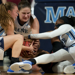 University of Maine's Sigi Koizar (from left), Fanny Wadling and Tanesha Sutton battle to gain control of a loose ball from Northeastern during their basketball game at the Cross Insurance Center in Bangor Wednesday.