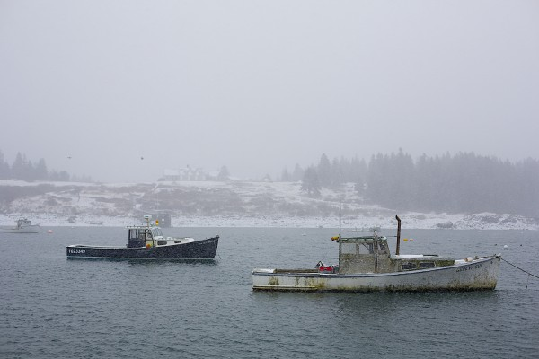 Fishing boats sit in a harbor in Isle Au Haut.