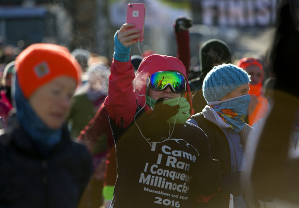 A runner captures the moment of running through downtown Millinocket during the second Millinocket Marathon and Half Saturday. The free race drew hundreds of people to the town.