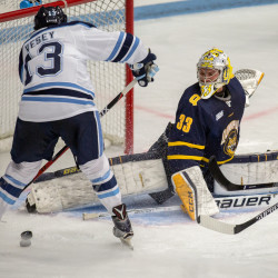 Quinnipiac goalie Chris Truehl stops a shot by the University of Maine's Chase Pearson (right) as the Black Bears' Nolan Vesey looks on during the first period of an Oct. 14 hockey game Alfond Arena in Orono.