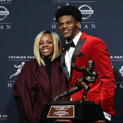 Louisville quarterback Lamar Jackson and his mother Felicia Jones pose with the trophy during a press conference at the New York Marriott Marquis after winning the 2016 Heisman Trophy award during a presentation at the Playstation Theater.