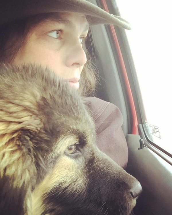 Lauren Pignatello sits with the stray dog she adopted in her truck in Standing Rock in North Dakota.