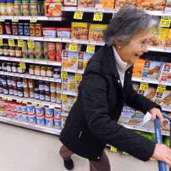 At Home Downeast volunteer and steering committee member Janet Simpson, 69, shopping for groceries at Tradewinds Marketplace in Blue Hill for 95-year-old member Dorothy Noble.